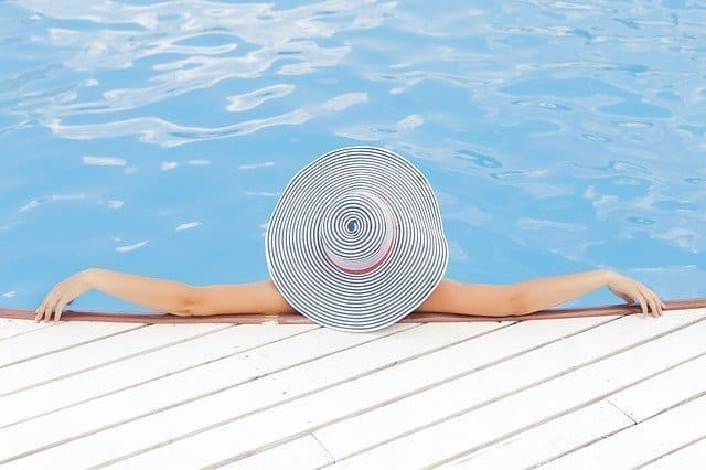 on vacation an iamge of a woman in swimng pool